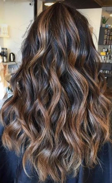 long brown hairstyle with golden blonde highlights