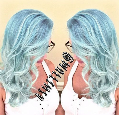 pastel blue wavy hairstyle with subtle highlights