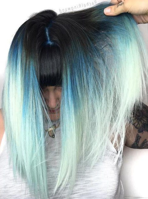 black roots and light blue tips