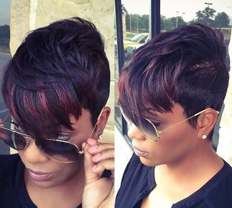 short black hair with caramel highlights in the bangs